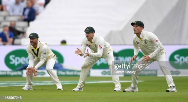 David Warner Steven Smith and Cameron Bancroft of Australia field in the slips during day one of the 1st Specsavers Ashes Test between England and...
