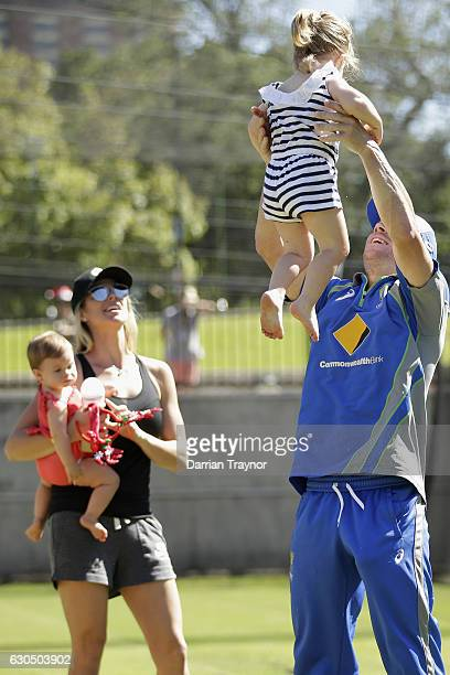 David Warner takes a break with his wife Candice and children Indi and Ivy during an Australian nets session on December 25 2016 in Melbourne...