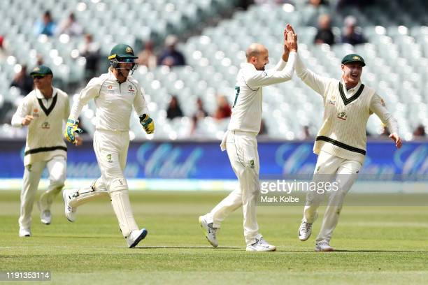 David Warner, Tim Paine, Nathan Lyon and Marnus Labuschagne of Australia celebrate Lyon taking the wicket of Shan Masood of Pakistan during day four...
