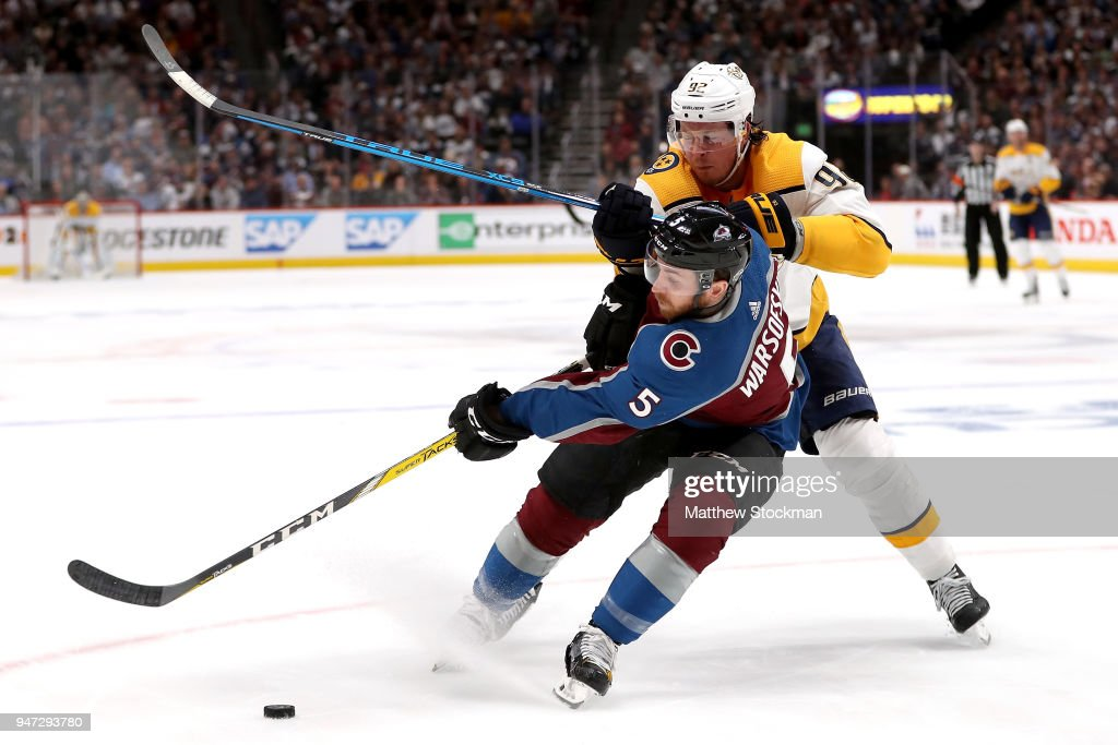 David Warsofsky #5 of the Colorado Rockies fights for control of the puck against Ryan Johansen #92 of the Nashville Predators in Game Three of the Western Conference First Round during the 2018 NHL Stanley Cup Playoffs at the Pepsi Center on April 16, 2018 in Denver, Colorado.