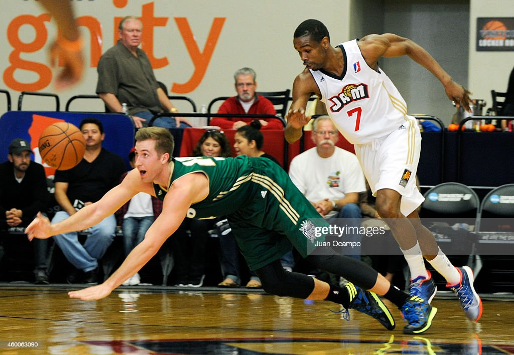 David Wear #14 of the Reno Bighorns dives for the loose ball against Renaldo Major #7 of the Bakersfield Jam during a D-League game on December 5, 2014 at Dignity Health Event Center in Bakersfield, California.