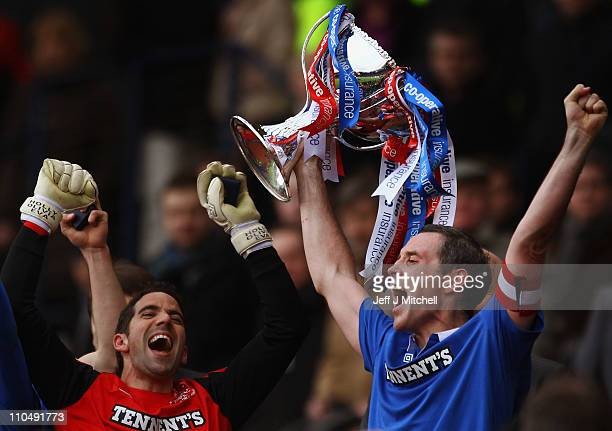 David Weir captain of Rangers lifts the Cooperative Insurance Cup after beating Celtic in the final at Hampden Park on March 20 2011 in Glasgow...