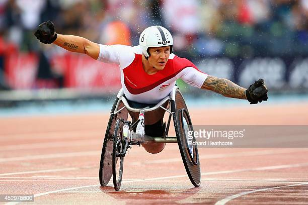 David Weir of England celebrates winning gold in the Men's T54 1500 metres final at Hampden Park during day eight of the Glasgow 2014 Commonwealth...