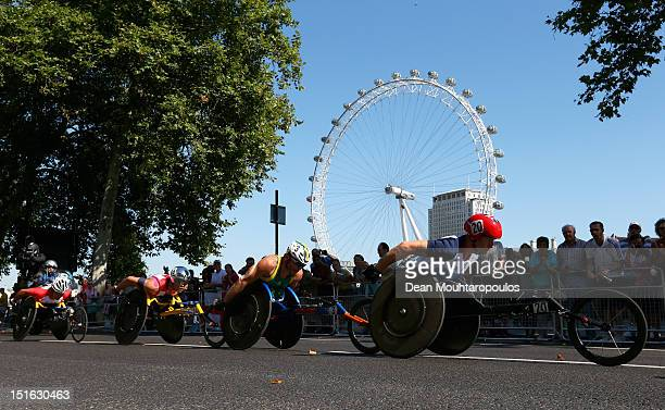 David Weir of Great Britain Kurt Fearnley of Australia and Marcel Hug of Switzerland compete in the Mens T54 Marathon near the London Eye on day 11...