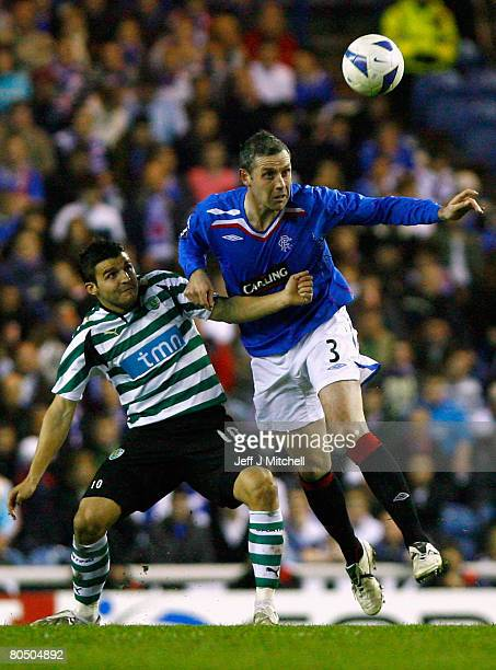 David Weir of Rangers and Simon Vukcevic of Sporting Lisbon vie for a header during the UEFA Cup Quarter Final first leg match at Ibrox Stadium April...