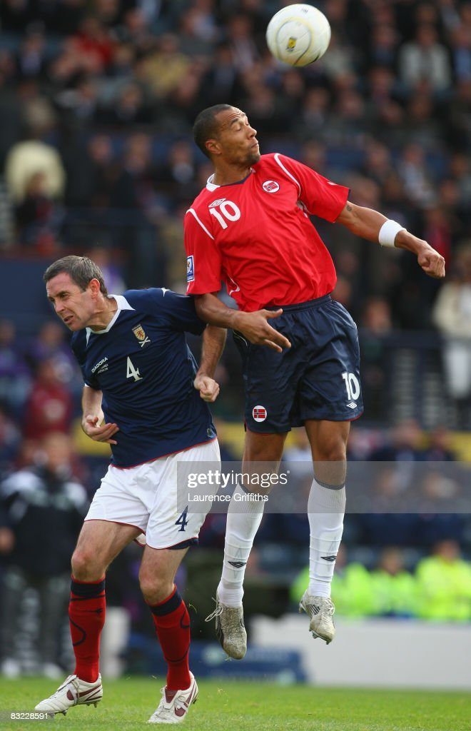 David Weir of Scotland battles with John Carew of Norway during the FIFA 2010 World Cup Qualifying Match between Scotland and Norway at Hampden Park on October 11, 2008 in Glasgow, Scotland.