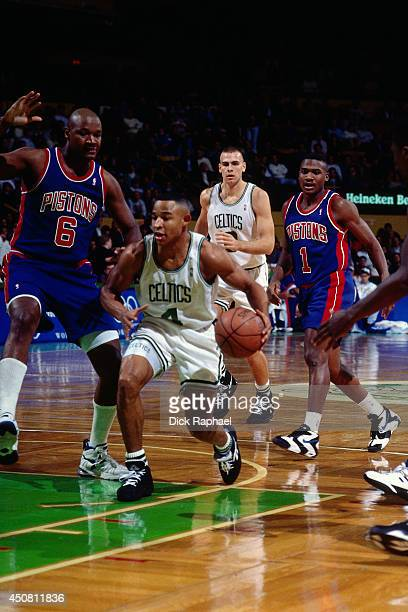 David Wesley of the Boston Celtics drives against Terry Mills of the Detroit Pistons during a game played in 1995 at the Boston Garden in Boston...
