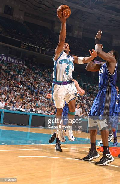 David Wesley of the Charlotte Hornets goes to the basket against Patrick Ewing of the Orlando Magic during game 2 of the Eastern Conference...