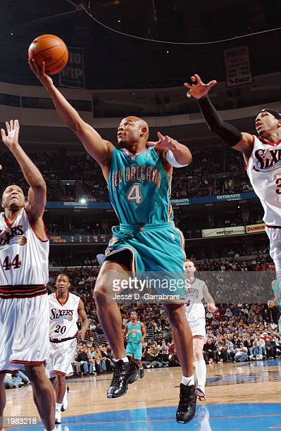 David Wesley of the New Orleans Hornets shoots a layup against Derrick Coleman and Allen Iverson of the Philadelphia 76ers in Game two of the Eastern...