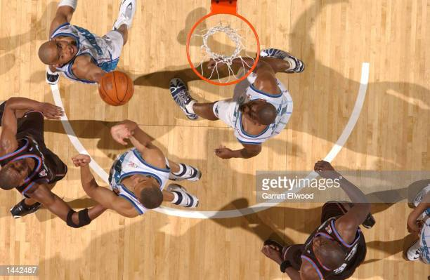 David Wesley#4 of the Charlotte Hornets goes to the basket against the Cleveland Cavaliers at the Charlotte Coliseum in Charlotte, North Carolina....