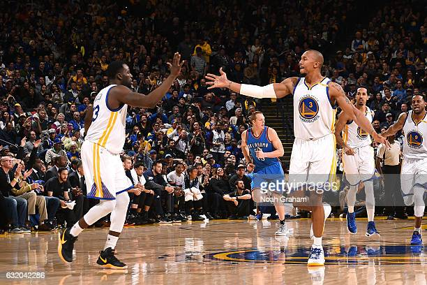 David West and Draymond Green of the Golden State Warriors high five each other during the game against the Oklahoma City Thunder on January 18 2017...