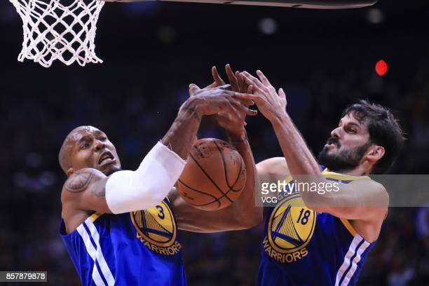 David West and Omri Casspi of the Golden State Warriors rebound the ball during the game between the Minnesota Timberwolves and the Golden State...