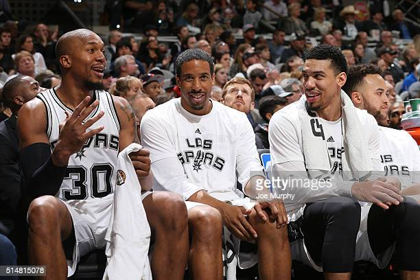 David West Andre Miller and Danny Green of the San Antonio Spurs sit on the bench during the game against the Chicago Bulls on March 10 2016 at the...