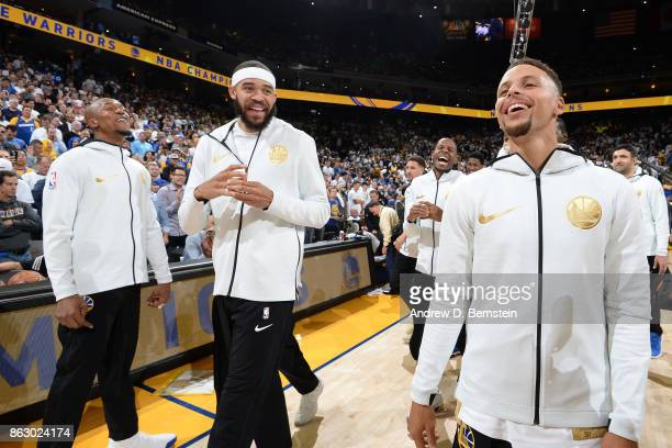 David West JaVale McGee and Stephen Curry of the Golden State Warriors smile and laugh during the championship ring ceremony before the game against...