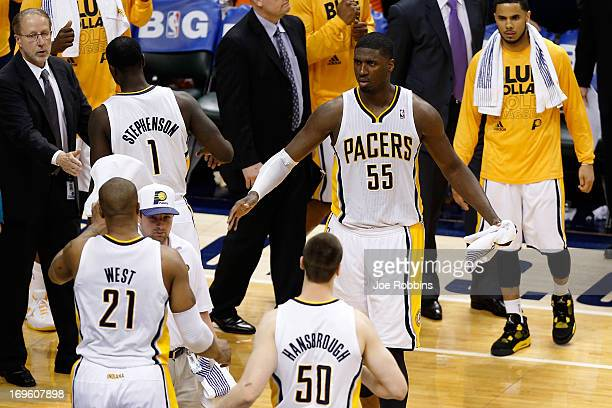 David West Lance Stephenson Tyler Hansbrough and Roy Hibbert of the Indiana Pacers celebrate with their teammates after they won 9992 against the...