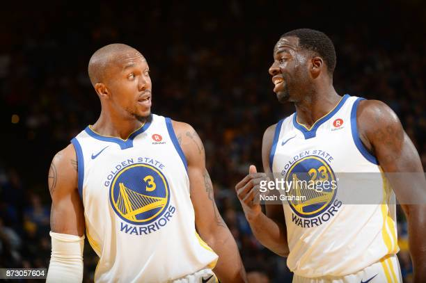 David West of the Golden State Warriors and Draymond Green of the Golden State Warriors speak during the game against the Philadelphia 76ers on...
