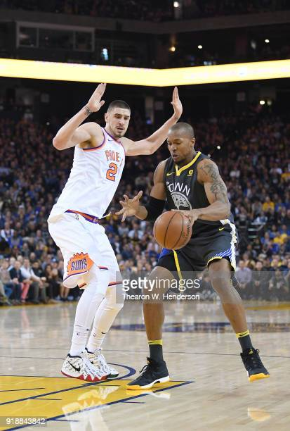 David West of the Golden State Warriors dribbles the ball while guarded by Alex Len of the Phoenix Suns during an NBA basketball game at ORACLE Arena...