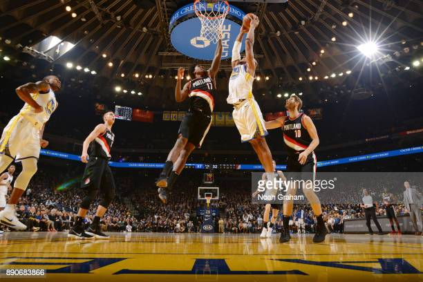 David West of the Golden State Warriors drives to the basket against the Portland Trail Blazers on December 11 2017 at ORACLE Arena in Oakland...