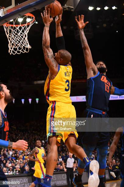 David West of the Golden State Warriors dunks the ball against the Oklahoma City Thunder on February 24 2018 at ORACLE Arena in Oakland California...