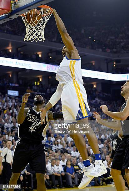 David West of the Golden State Warriors goes up for a slam dunk against the San Antonio Spurs during the first quarter in an NBA basketball game at...
