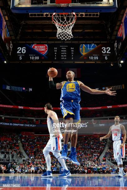David West of the Golden State Warriors grabs the rebound against the Detroit Pistons on December 8 2017 at Little Caesars Arena in Detroit Michigan...