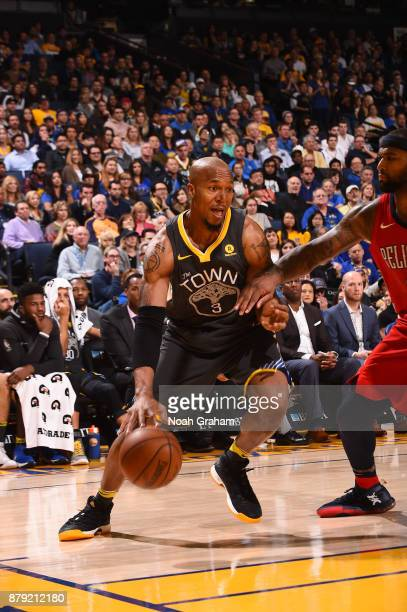 David West of the Golden State Warriors handles the ball against the New Orleans Pelicans on November 25 2017 at ORACLE Arena in Oakland California...