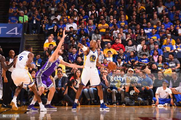David West of the Golden State Warriors handles the ball during preseason game against the Sacramento Kings on October 13 2017 at ORACLE Arena in...