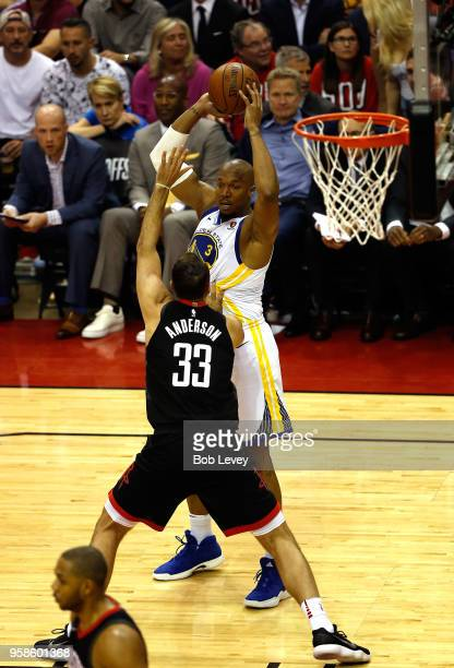 David West of the Golden State Warriors looks to pass against Ryan Anderson of the Houston Rockets in the first half in Game One of the Western...