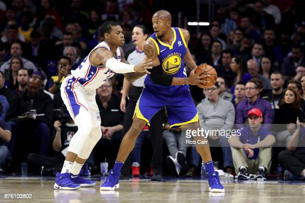 David West of the Golden State Warriors looks to pass in front of Richaun Holmes of the Philadelphia 76ers at Wells Fargo Center on November 18 2017...