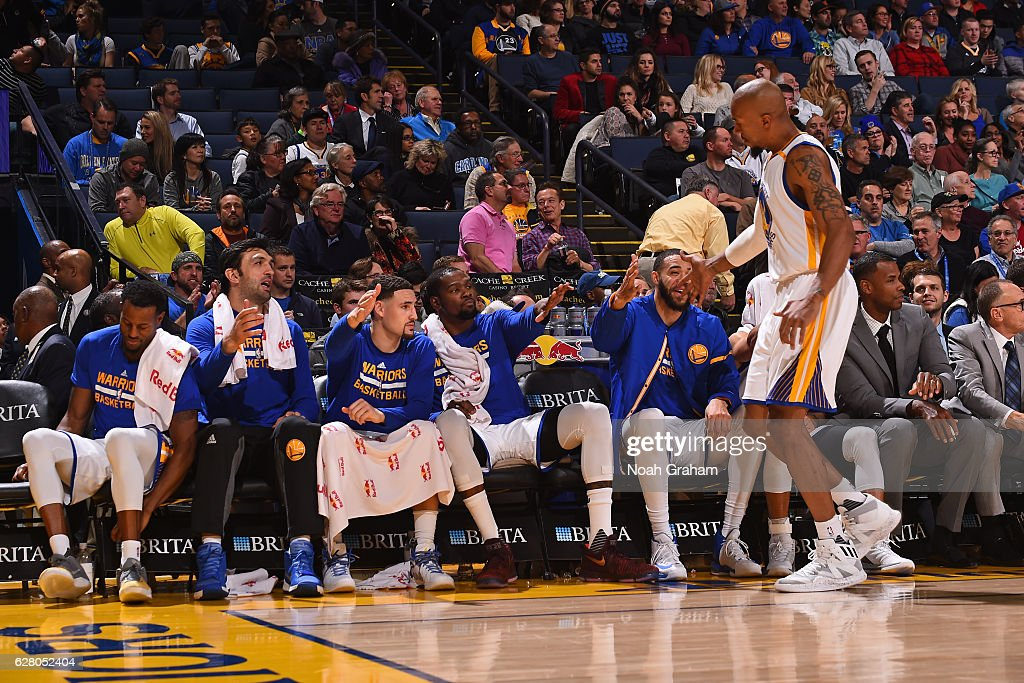 David West #3 of the Golden State Warriors shakes hands with the bench during the game against the Indiana Pacers on December 5, 2016 at ORACLE Arena in Oakland, California.