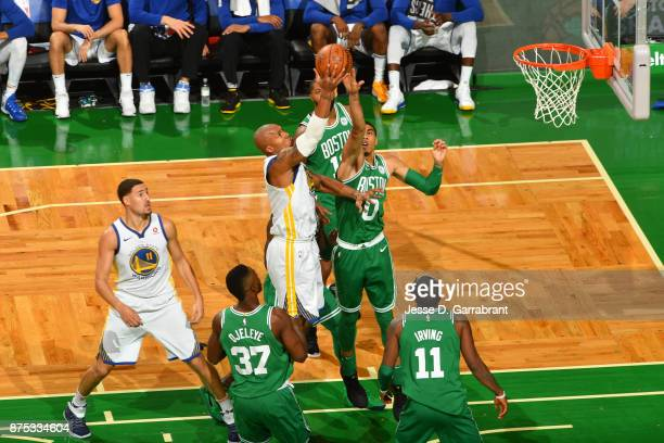 David West of the Golden State Warriors shoots the ball against Jayson Tatum of the Boston Celtics on November 16 2017 at the TD Garden in Boston...