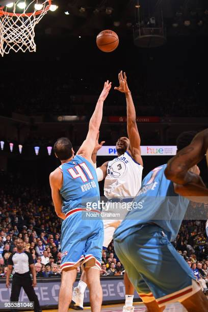 David West of the Golden State Warriors shoots the ball during the game against the Sacramento Kings on March 16 2018 at ORACLE Arena in Oakland...