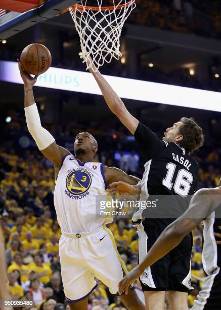 David West of the Golden State Warriors tries to shoot over Pau Gasol of the San Antonio Spurs during Game Five of Round One of the 2018 NBA Playoffs...