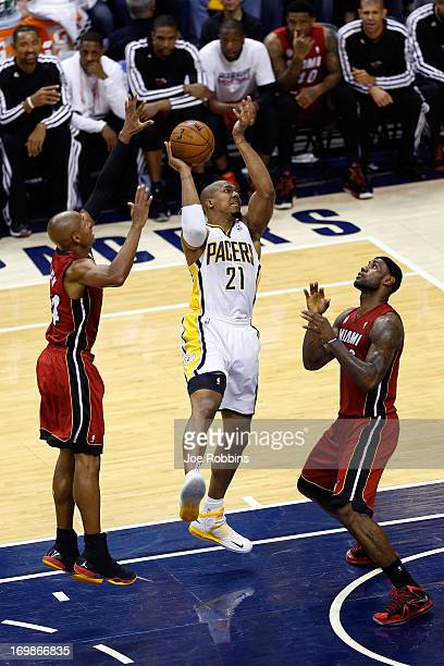 David West of the Indiana Pacers against LeBron James and Ray Allen of the Miami Heat in Game Six of the Eastern Conference Finals during the 2013...