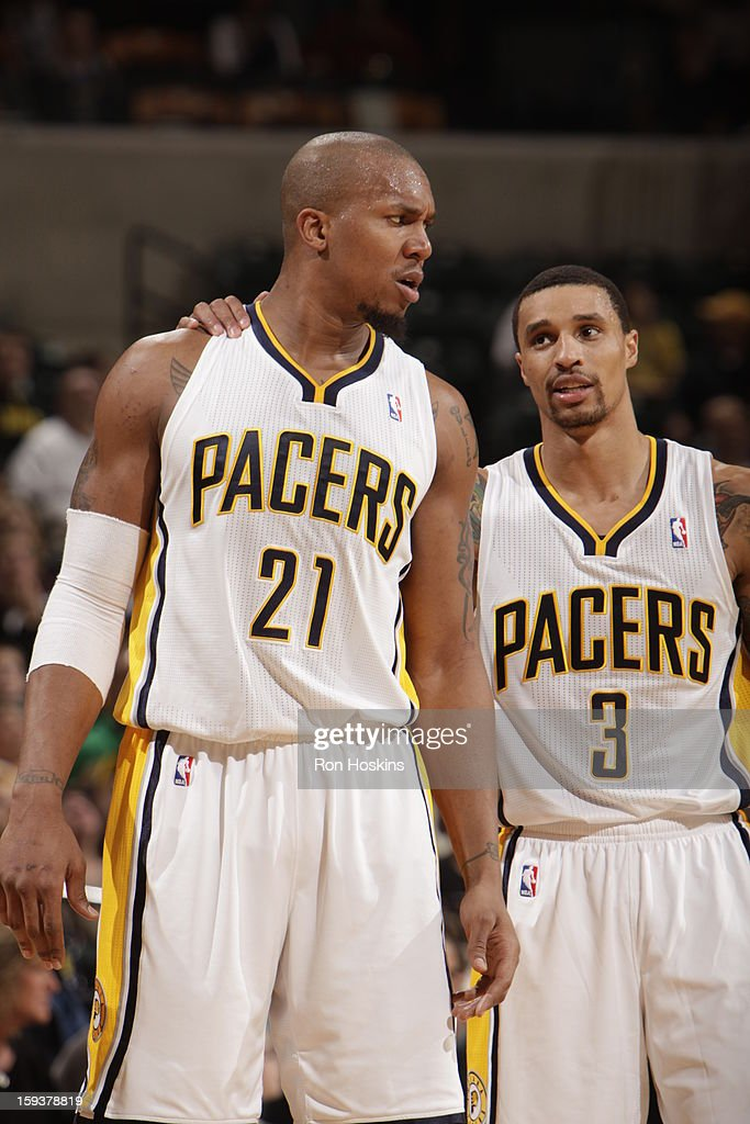 David West #21 of the Indiana Pacers and George Hill #3 of the Indiana Pacers confer during the game between the Indiana Pacers and the Charlotte Bobcats on January 12, 2013 at Bankers Life Fieldhouse in Indianapolis, Indiana.