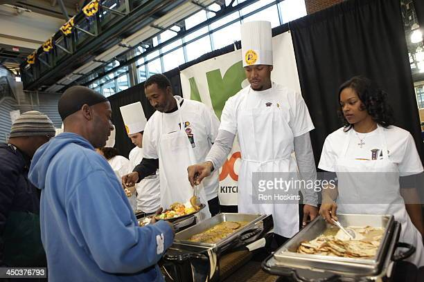 David West of the Indiana Pacers and his wife Lesley serve up a dish as part of the Pacers 16th Annual 'Come to Our House' Thanksgiving Diner at...