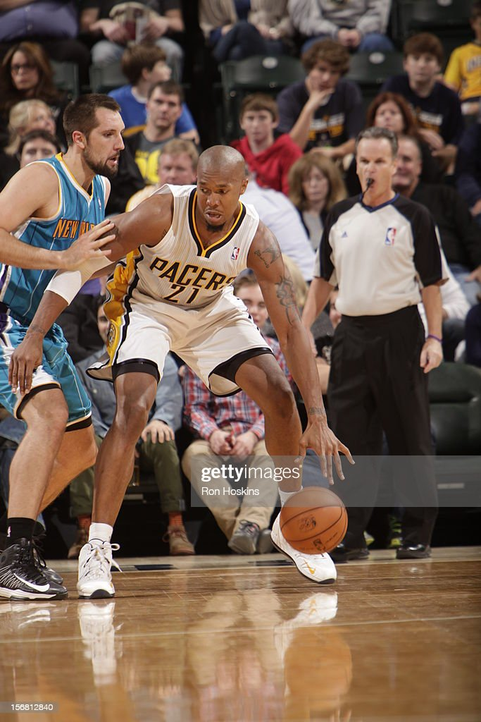 David West #21 of the Indiana Pacers backs up to the basket vs the New Orleans Hornets on November 21, 2012 at Bankers Life Fieldhouse in Indianapolis, Indiana.