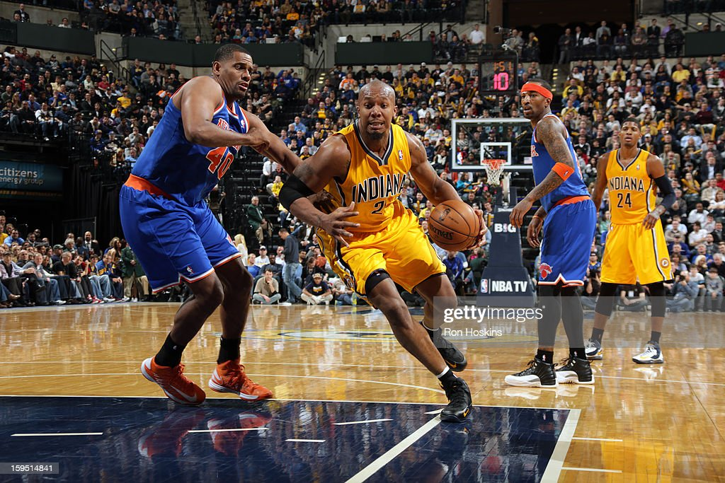 David West #21 of the Indiana Pacers drives to the basket against Kurt Thomas #40 of the New York Knicks on January 10, 2013 at Bankers Life Fieldhouse in Indianapolis, Indiana.