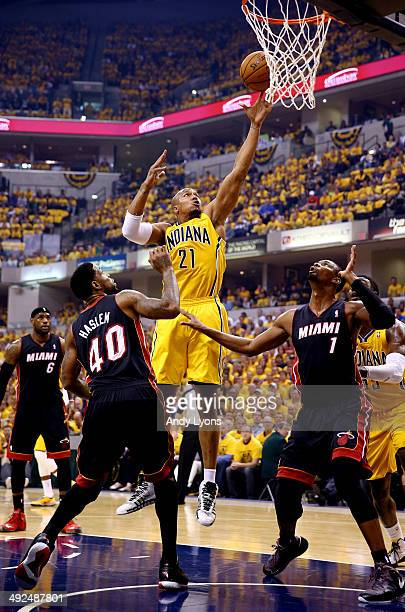 David West of the Indiana Pacers goes up for a basket as Udonis Haslem and Chris Bosh of the Miami Heat defend during Game Two of the Eastern...