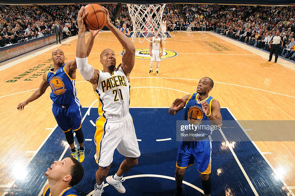 David West #21 of the Indiana Pacers grabs a rebound against the Golden State Warriors on February 26, 2013 at Bankers Life Fieldhouse in Indianapolis, Indiana.