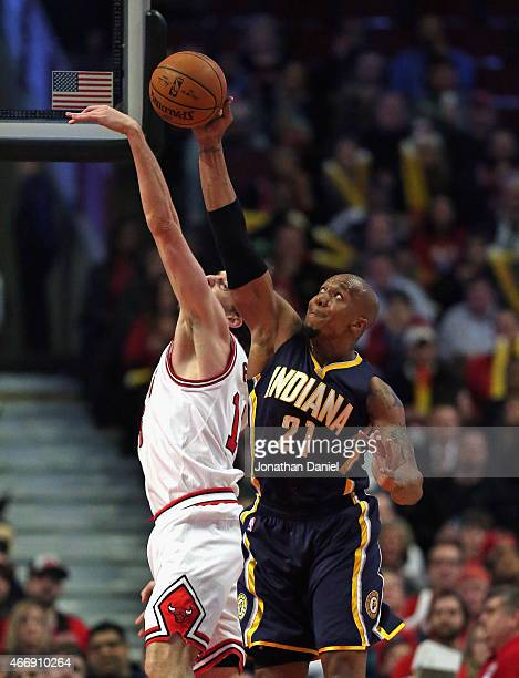 David West of the Indiana Pacers grabs Indiana Pacers rebound against Pau Gasol of the Chicago Bulls at the United Center on March 18 2015 in Chicago...