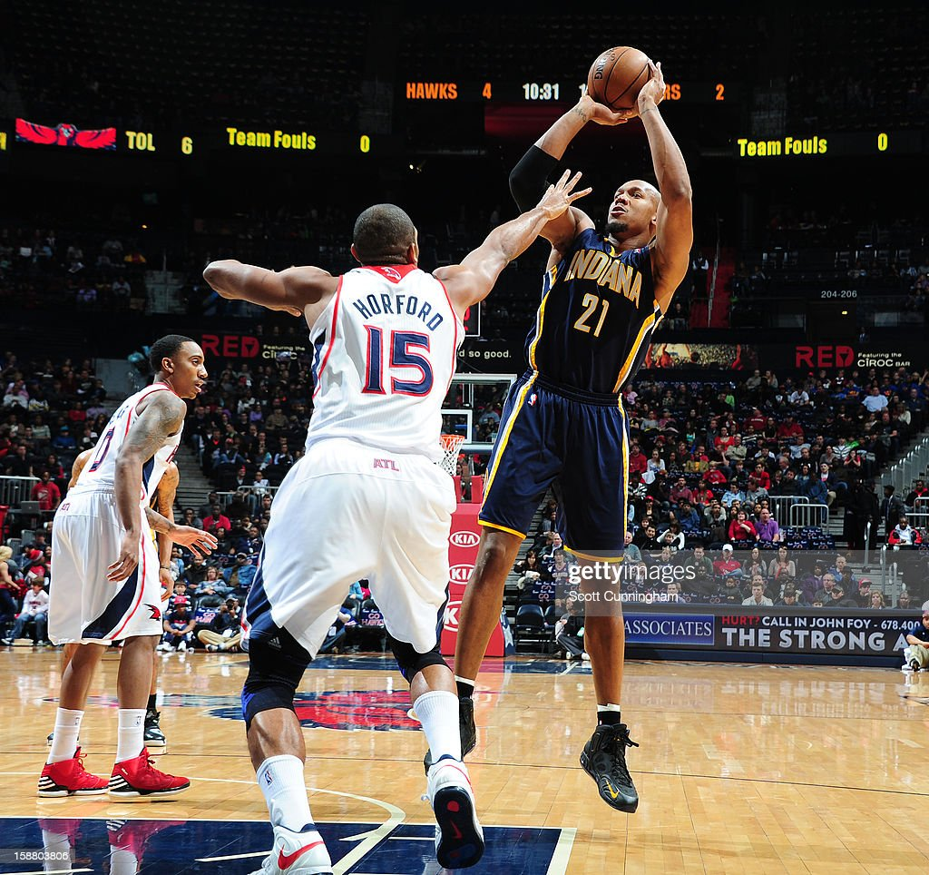 David West #21 of the Indiana Pacers shoots against Al Horford #15 of the Atlanta Hawks on December 29, 2012 at Philips Arena in Atlanta, Georgia.