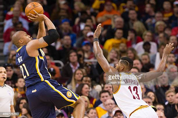 David West of the Indiana Pacers shoots over Tristan Thompson of the Cleveland Cavaliers during the first half at Quicken Loans Arena on November 29...
