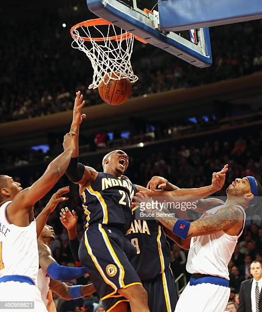 David West of the Indiana Pacers sinks one against Kenyon Martin of the New York Knicks at Madison Square Garden on November 20 2013 in New York City...