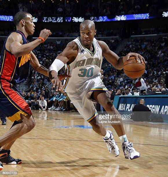 David West of the New Orleans Hornets drives around Monta Ellis of the Golden State Warriors on April 6 2008 at the New Orleans Arena in New Orleans...