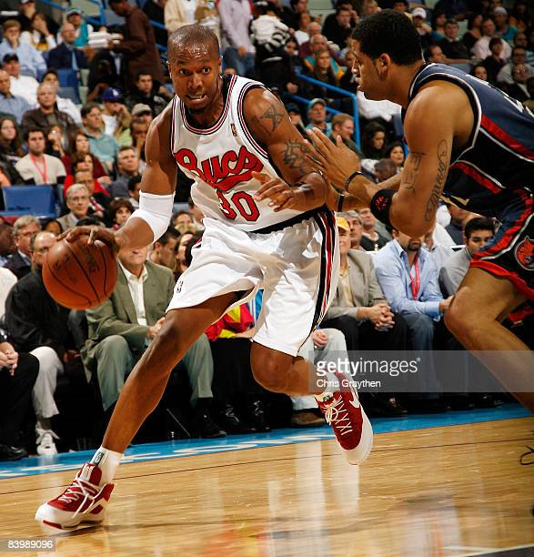 David West of the New Orleans Hornets drives the ball around Sean May of the Charlotte Bobcats at the New Orleans Arena December 10 2008 in New...