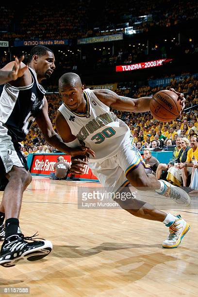 David West of the New Orleans Hornets drives to the basket against Kurt Thomas of the San Antonio Spurs in Game One of the Western Conference...