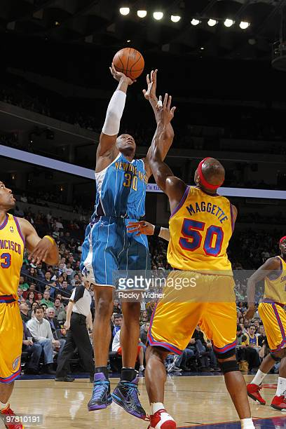 David West of the New Orleans Hornets pulls up for a jumper against Corey Maggette of the Golden State Warriors on March 17 2010 at Oracle Arena in...