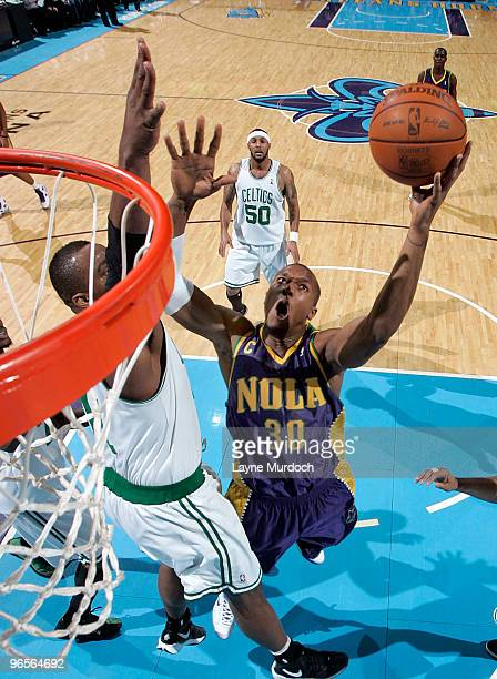 David West of the New Orleans Hornets shoots over Glen Davis of the Boston Celtics on February 10 2010 at the New Orleans Arena in New Orleans...