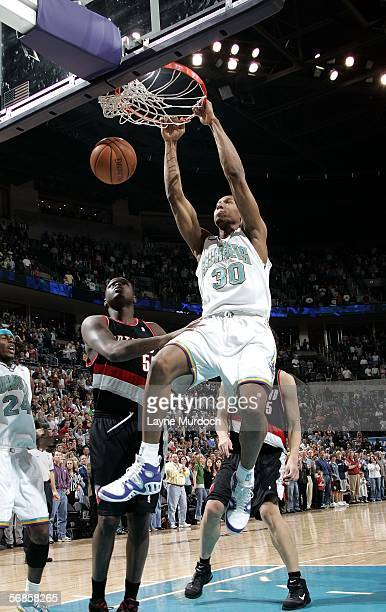 David West of the New Orleans/Oklahoma City Hornets dunks against Zach Randolph the Portland Trail Blazers on February 15 2006 at the Ford Center in...